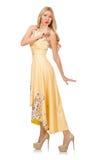 La fille blonde dans la robe avec du charme avec la fleur imprime Photo stock