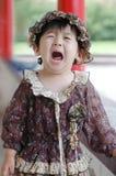 La fille chinoise pleurante Photographie stock