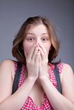 La fille a couvert sa bouche Photographie stock