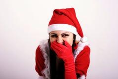 La fille dans des vêtements de Noël. Photos libres de droits