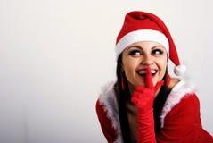 La fille dans des vêtements de Noël. Images stock