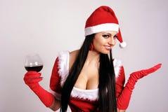 La fille dans des vêtements de Noël. Photographie stock libre de droits