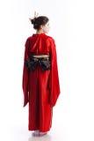 La fille dans le costume indigène du geisha japonais Photo libre de droits