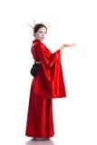La fille dans le costume indigène du geisha japonais Image libre de droits
