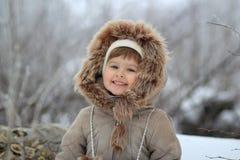 La fille dans un capot Photographie stock libre de droits