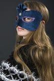 La fille dans un masque Photo stock