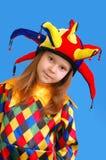 La fille dans un procès du clown Image libre de droits