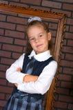 La fille dans un uniforme scolaire Photos libres de droits