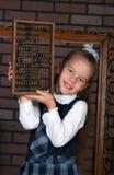 La fille dans un uniforme scolaire Photos stock