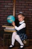La fille dans un uniforme scolaire Photographie stock