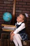 La fille dans un uniforme scolaire Images stock