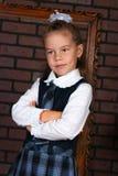 La fille dans un uniforme scolaire Photo libre de droits