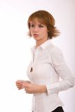 La fille dans une chemise blanche Photo stock