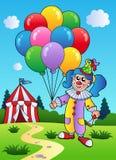 La fille de clown avec des ballons s'approchent de la tente Photographie stock libre de droits