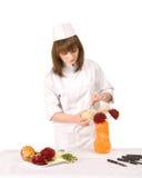 La fille de cuisinier décore un vase Photos libres de droits