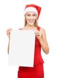 La fille de Santa affiche un espace blanc Photographie stock libre de droits