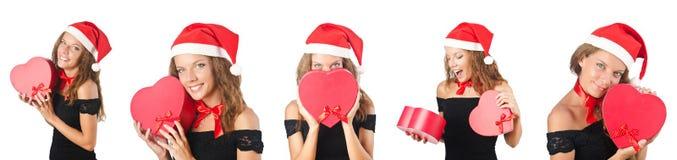 La fille de Santa avec des giftboxes sur le blanc Image stock