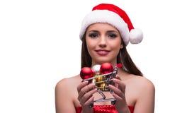 La fille de Santa avec la décoration de caddie et de Noël Photos stock
