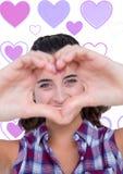 La fille de valentines avec amour remet le fond de coeurs de forme et d'amour Photographie stock libre de droits