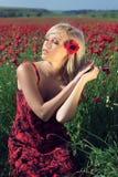 La fille en fleurs Image libre de droits