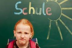 La fille est fâchée au sujet de l'école Photographie stock libre de droits