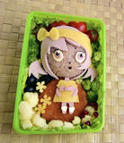 La fille est faite de riz Kyaraben, bento Photos stock