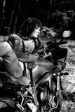 La fille et la moto de pouvoir Image stock