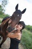 La fille et le cheval Photo stock