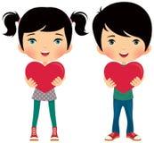 La fille et le garçon donnent le valentine Photographie stock libre de droits