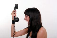 La fille et le téléphone Photographie stock libre de droits