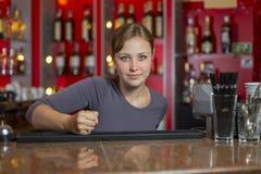 La fille frappe sur la table Images libres de droits