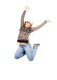 La fille géniale d'adolescent saute dans l'extase d'isolement Photographie stock libre de droits