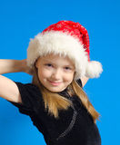 La fille l'adolescent dans le chapeau du père noël Photo stock