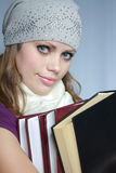 La fille a le contrôle des livres Photographie stock libre de droits