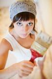 La fille le peintre de maison Photographie stock libre de droits