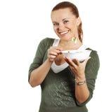La fille mange de la salade Photos stock