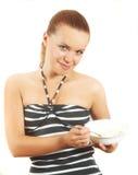 La fille mange du fromage blanc Photo libre de droits
