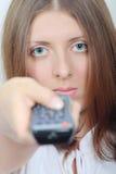 La fille mignonne avec un panneau de commande Photo stock