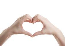 La fille montre à des mains un coeur photos stock