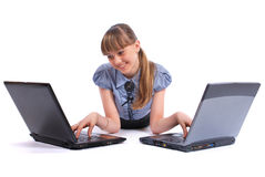 La fille près de deux ordinateurs portatifs Photos stock