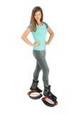 La fille s'est habillée dans des chaussures de sauts de kangoo Photographie stock libre de droits