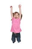 La fille sautant pour la joie Photo stock