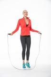 La fille saute avec la corde à sauter Image stock