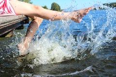 La fille sur le dock Photographie stock libre de droits