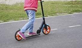La fille sur le scooter Photo libre de droits