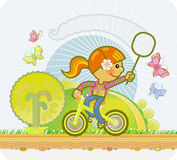 La fille sur une bicyclette Photo stock