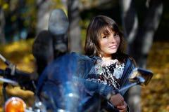 La fille sur une moto Images stock