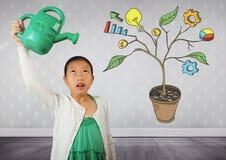 La fille tenant la boîte d'arrosage et dessin des graphiques de gestion sur l'usine s'embranche sur le mur Photo stock