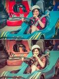 La fille thaïlandaise mignonne conduit le kart par le point de départ dans le vin photo libre de droits