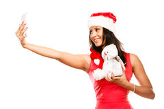 La fille tient le bonhomme de neige prenant le selfie Photos libres de droits